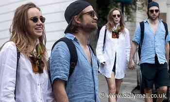 Suki Waterhouse borrows one of beau Robert Pattinson's shirts as they enjoy a romantic stroll - Daily Mail
