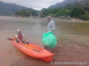 Limpiar el dique El Cadillal fue la promesa de amor que se hizo un grupo de voluntarios - La Gaceta