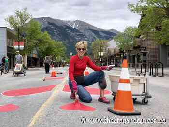 Joining Hearts Responsibly on Main Street Canmore - The Crag and Canyon