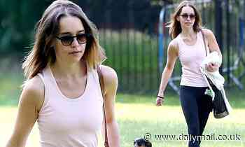 Emilia Clarke makes the most of the sunshine as she enjoys a day at the park with beloved pet pooch - Daily Mail