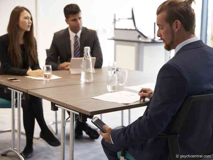 Using Phone in a Work Meeting May Leave a Bad Impression