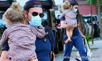 Bradley Cooper the doting dad carries his little girl Lea while wearing a mask on outing in NYC