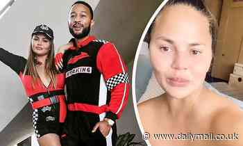 Chrissy Teigen zips into racy pit girl outfit after revealing results of breast surgery