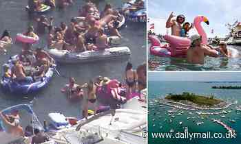 Out of control lake party as hundreds of boaters without masks gather off sandbar island in Michigan