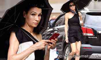 Famke Janssen, 55, keeps cool in scorching NYC temperatures in off-the shoulder mini dress - Daily Mail