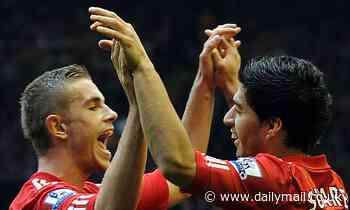 Barcelona striker Luis Suarez congratulates former club Liverpool and captain Jordan Henderson