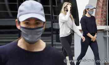 Jennifer Garner covers up in grey mask and cap for morning stroll with a pal