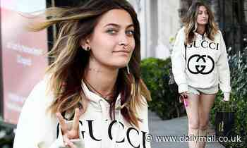 Paris Jackson appears in great spirits as she showcases her new neck tattoo in LA