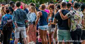 Revellers enjoy drinks in the sunshine one week before pubs reopen in England