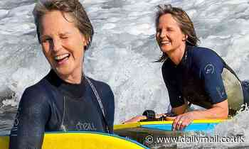 Helen Hunt wears a wetsuit as she catches some waves while bodyboarding in Malibu