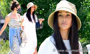 Cara Santana wears a floppy gold hat as she catches up with her gal pal Ashley Greene