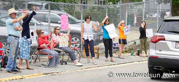 Teachers do the wave for departing students at Ste Jeanne d'Arc - Lowell Sun