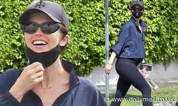 Pregnant Katherine Schwarzenegger smiles behind face mask