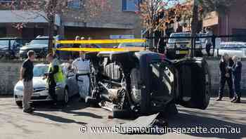 Car lands on top of parked car at Blaxland - Blue Mountains Gazette