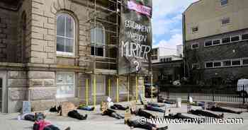 Protesters climb historic building in Cornwall to accuse government of murder - Cornwall Live