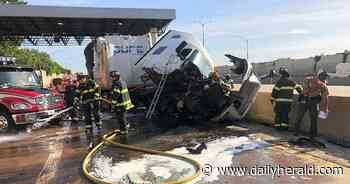 Two hurt when truck hits tollbooth divider near Glenview