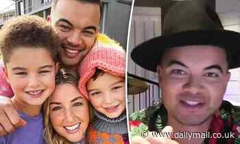 Guy Sebastian beams alongside his wife Jules and his lookalike sons Hudson, eight, and Archer, six