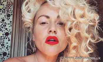 Jaime Winstone puts on a sultry display with a red lip for sexy selfie