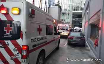 Vehículo cae de elevador de agencia de autos en Santa Fe; hay un muerto - Milenio