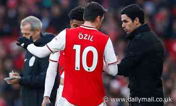 Mikel Arteta states that Mesut Ozil's wages are 'never' considered when picking his Arsenal team