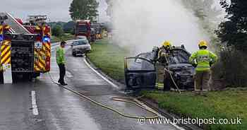 Car fire breaks out on side of busy road
