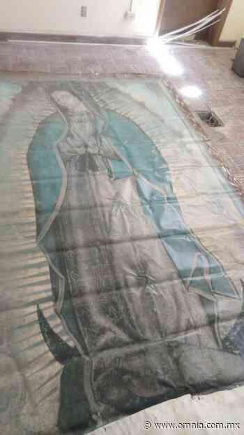 Resguardan cuadro de la Virgen de Guadalupe que se desprendió durante los fuertes vientos en Juárez - Omnia