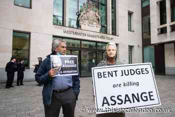 Assange told to attend court hearing after 'torture' claims