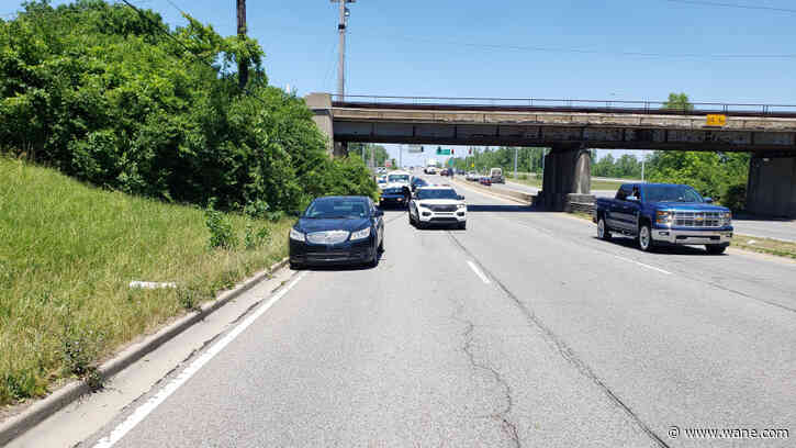 Woman hit by vehicle while pushing infant in stroller