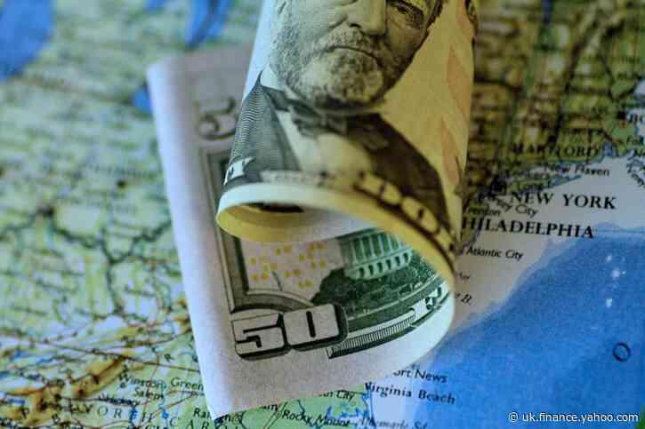 Dollar on defensive as upbeat data dulls safe-haven appeal