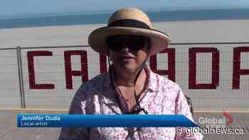 Cobourg artist brings Canada Day cheer even with Victoria beach closed for the season | Watch News Videos Online - Globalnews.ca