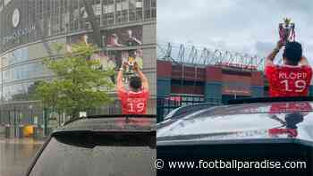 Liverpool fan takes replica Premier League trophy for photo at Old Trafford - Football Paradise