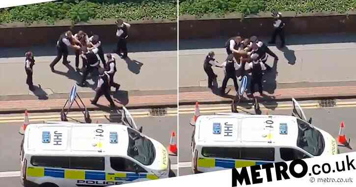 Investigation launched after black man 'punched and kicked' by police in street