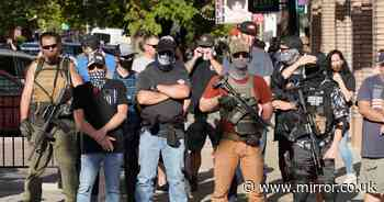 Black Lives Matter protesters face off with armed pro-police counter group