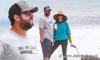 Adam Sandler hits the beach in Malibu with wife Jackie, their dog and a couple of boogie boards - Daily Mail