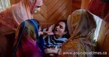 Photo of toddler sitting on slain grandpa angers Kashmiris - Assiniboia Times