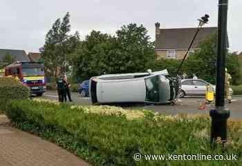 Car overturns in crash