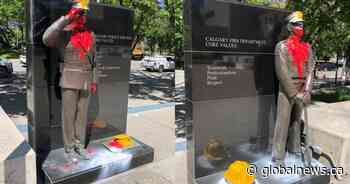 Police, firefighter statues vandalized with paint outside Calgary city hall