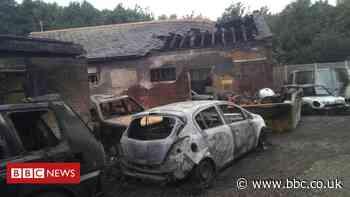 Roydon workshop fire: Seven vehicles destroyed