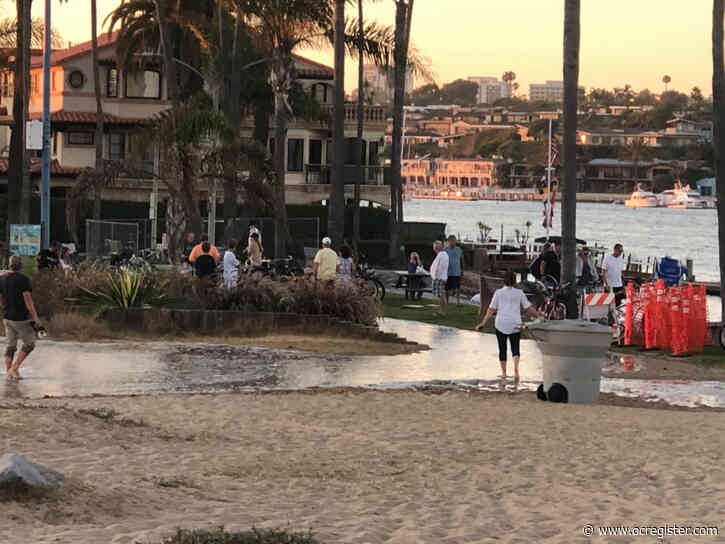High tide, massive surf causes flooding along Balboa Peninsula
