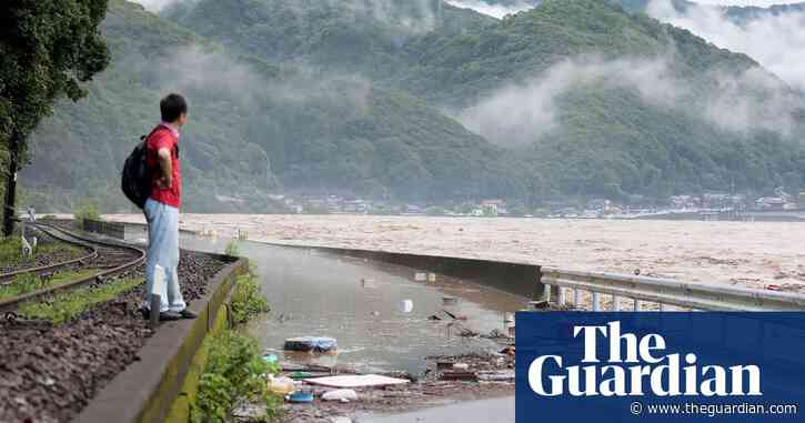 At least two people die as record heavy rain lashes Japan