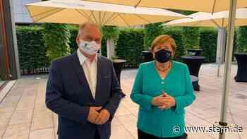 News im Video: Angela Merkel zeigt sich erstmals öffentlich mit Maske - STERN.de