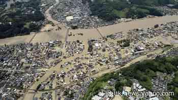 Dozen feared dead after flooding and landslides hit southern Japan