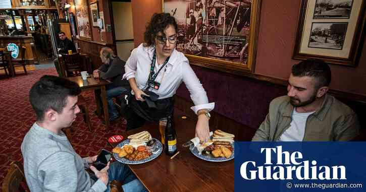 English pubs pour first pints for customers since lockdown began