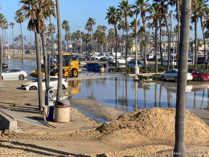 Clean up in Newport Beach after big surf and high tides caused flooding, sailboat capsize