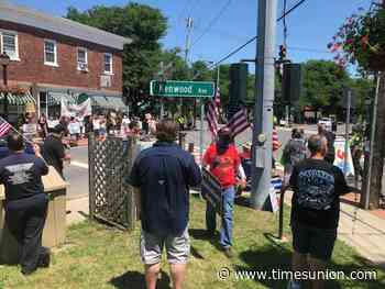 Tense moments at competing rallies at Delmar intersection