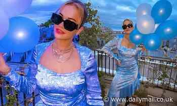 Rita Ora exudes elegance in a blue floral satin dress