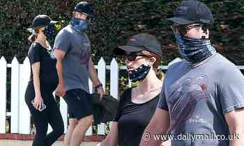 Katherine Schwarzenegger shows off growing baby bump in black on walk with husband Chris Pratt