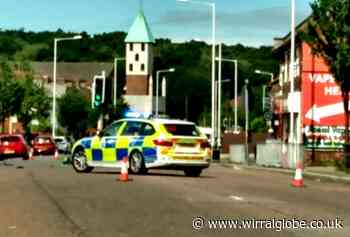 Road closure after crash in Birkenhead North