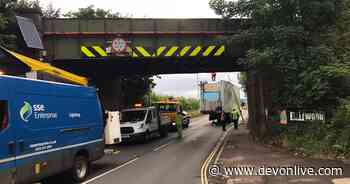 Busy Exeter road closed after lorry hits bridge - updates - Devon Live