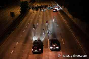 1 killed, 1 injured after car hits protesters on closed Seattle highway